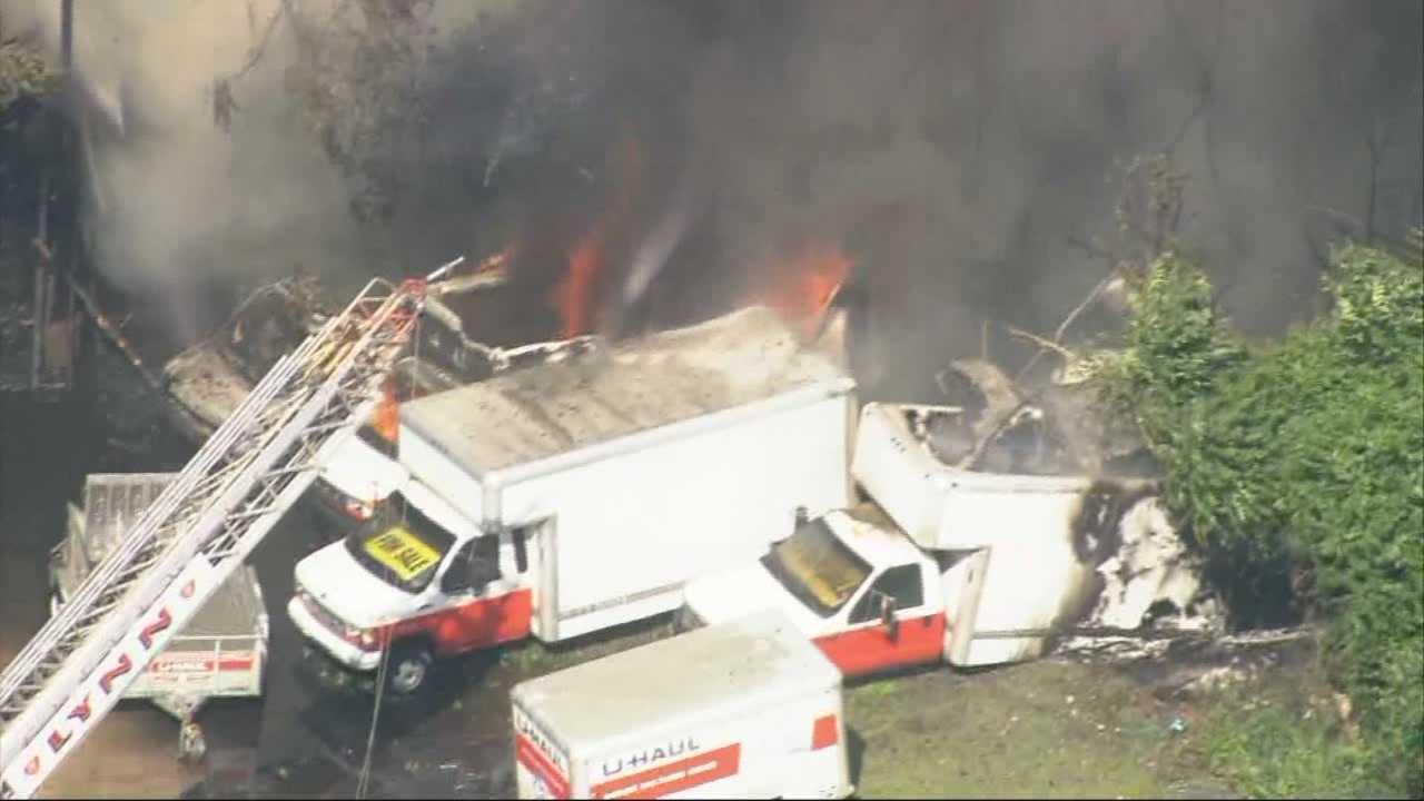 Fire strikes vacant warehouse, U-Haul trucks