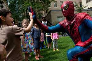 He visited the new James Mandell Building's enclosed healing garden and traded fist bumps and crime-fighting tips with some of his biggest fans.