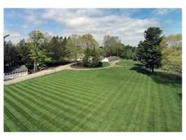 The home is situated on more than thirteen acres of exquisitely landscaped grounds.