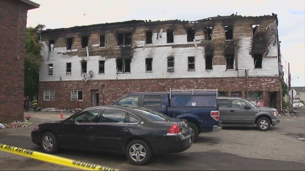 Child may have run back into burning apartment for mother
