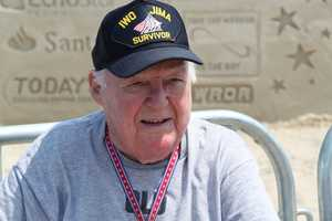 Bob Quinn, 93, from Peabody, Mass., fought in the battle of Iwo Jima in the Marines and was 100 yards away when the flag was raised.
