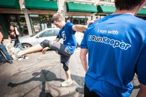 Fourrunners handpicked by RunKeeper face offagainst a Green Line trolley leaving fromBostonCollege station