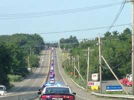 The long line of police cruisers approaching Foxborough.