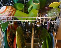 Disinfect it by pouring vinegar into a dishwasher-safe cup, then place the cup upright on (empty) dishwasher's top rack. Run a full cycle.