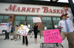 Market Basket employees Rees Gemmell, far right, and colleagues acknowledge passing supporters as they picket in front of the store in Haverhill, Mass., Thursday, July 24, 2014.