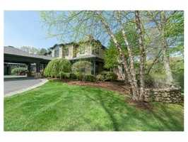 Significant residence with porte cochere car entry and old world main hall with commanding limestone fireplace.