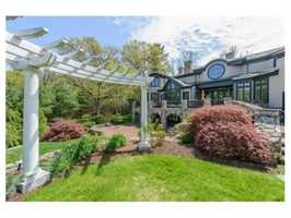 Set on 3.28 acres of land on a private cul-de-sac in one of Weston's most exclusive south side neighborhoods