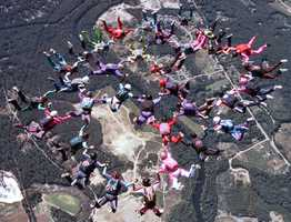 Skydivers form a 33-way formation to break a New England Womens Skydiving Record at Skydive Pepperell in Pepperell, Mass., Saturday, Aug. 25, 2001.