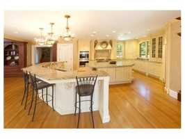 Impressive spaces include a highly functional custom designed two-cook kitchen.