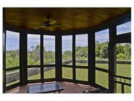 Enjoy a relaxing sunroom, study, plus third floor family room.
