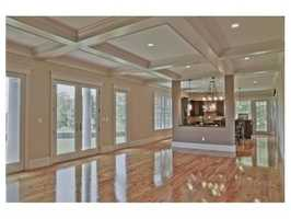 There are gleaming hardwood floors.