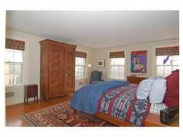 Second floor master suite with fireplace, bath en-suite, walk-in closet and dressing room.