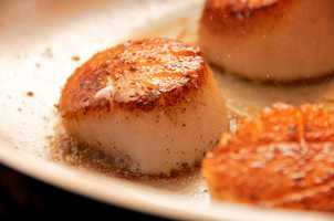 Scallops A 132-pound person can safely eat 36 ounces per week.A 44-pound child can safely eat 18 ounces per week.