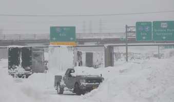 Dozens of trucks remained stuck along the New York State Thruway just south of Buffalo, two days after a ferocious lake-effect storm dumped up to six feet of snow.