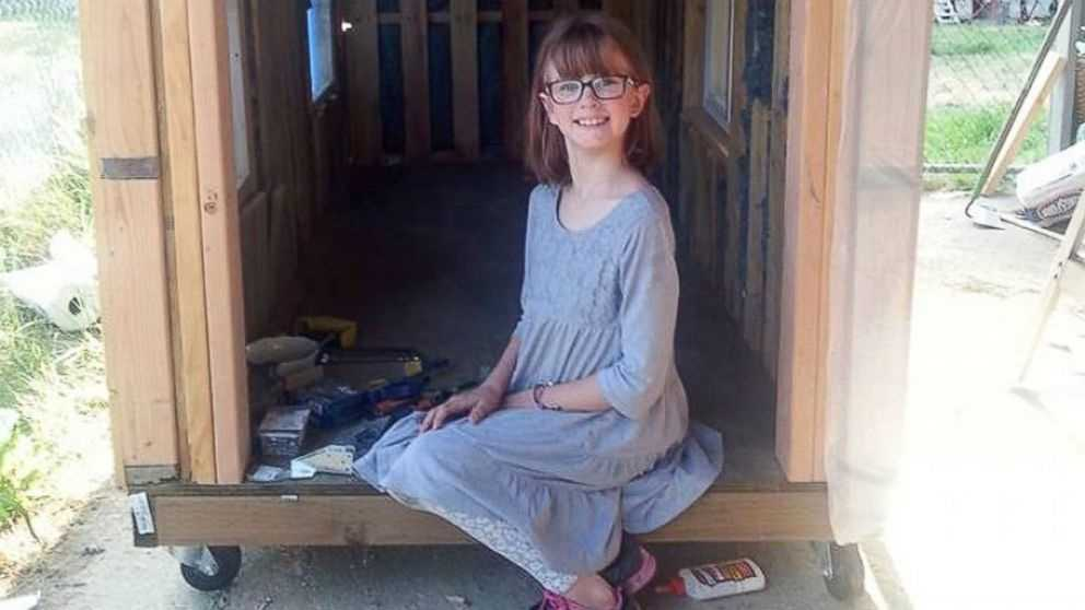 Personal Emergency Shelters : Year old girl building personal homeless shelters for