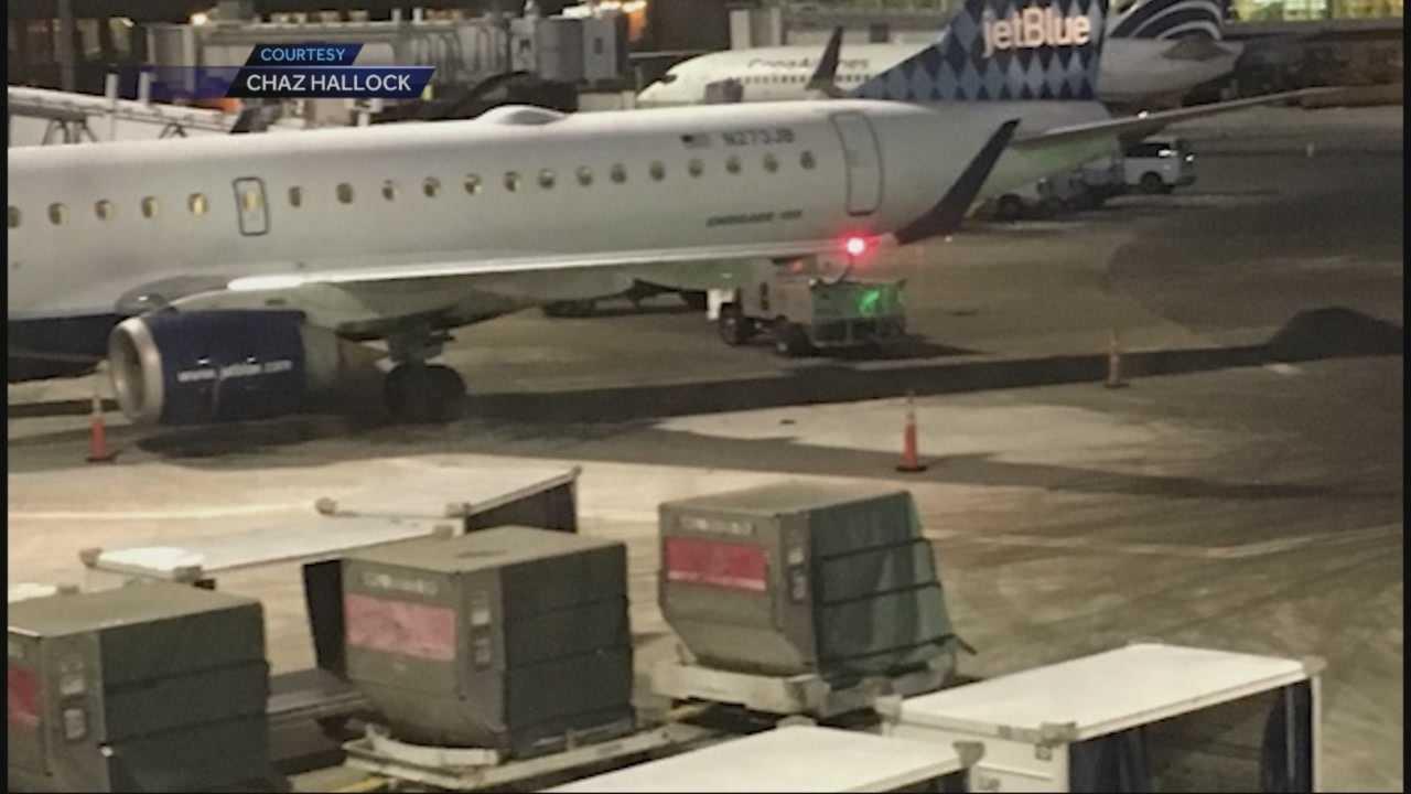 Runaway van hits plane at Logan