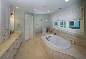 The master bedroom has a large walk in closet, as well as an ensuite bathroom.