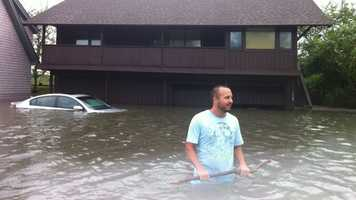 This Connecticut man swam back to his house to find his car underwater.
