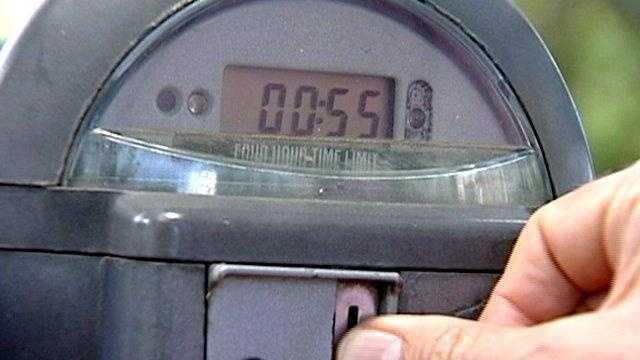 Placing change in parking meter