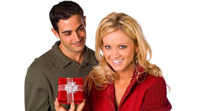 man giving woman present gift