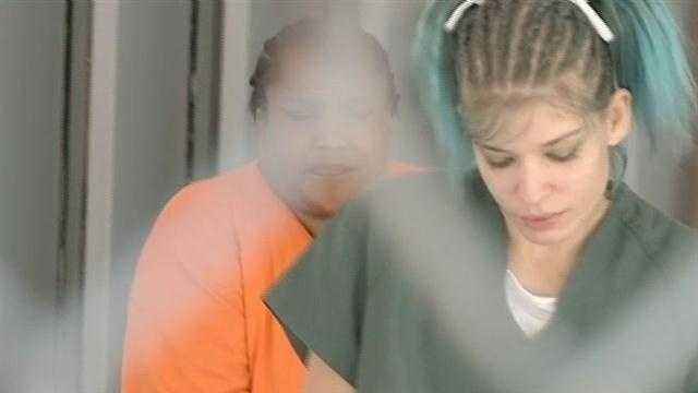 A woman  who is under investigation in the death and disappearance of a Bourbon Street dancer and who is being held on unrelated charges appeared in court Tuesday.