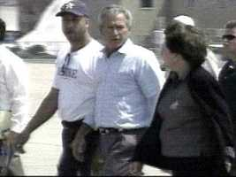 2005: Nagin meets with then President George W. Bush and Kathleen Blanco after the storm ravaged the city.