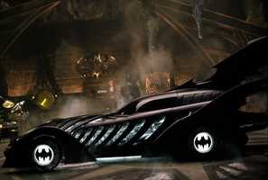 1995 Batmobile (Batman Forever): The full-scale vehicle was powered by a 25-gallon propane tank. When it was fired at full capacity, it could shoot a 25-foot flame out of the rear exhaust. Production designer Barbara Ling wanted the Batmobile to look like an organic machine always in motion. Thus the fin design's structure mirrored a real bat's wing.