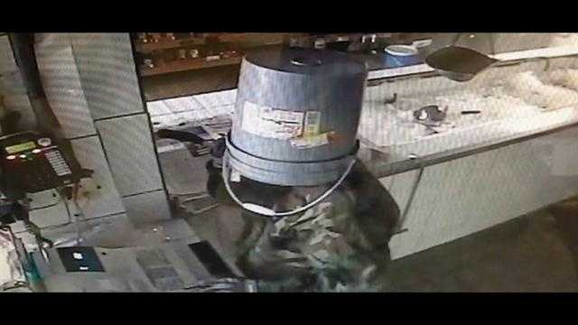Raw Video: Burglar uses bucket to conceal identity