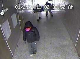 Police release surveillance photos from a burglary at Belle Chasse High School.