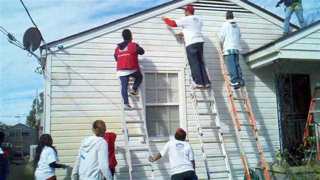 More than 200 volunteers from Rebuilding Together, Lowe's and NFL players join for 18th annual kickoff to rebuild on the Westbank.