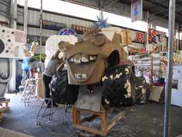 Once carved, the sculpture moves to paper mache, where artists apply brown paper with a paste made of flour and water.