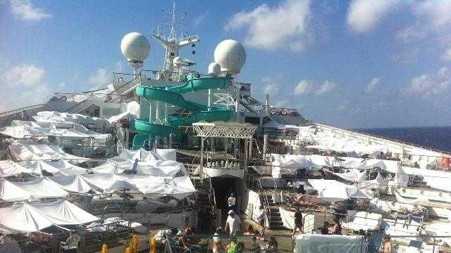 "Sheets and canopies give the deck of the disabled Carnival Triumph the appearance of a ""tent city."""