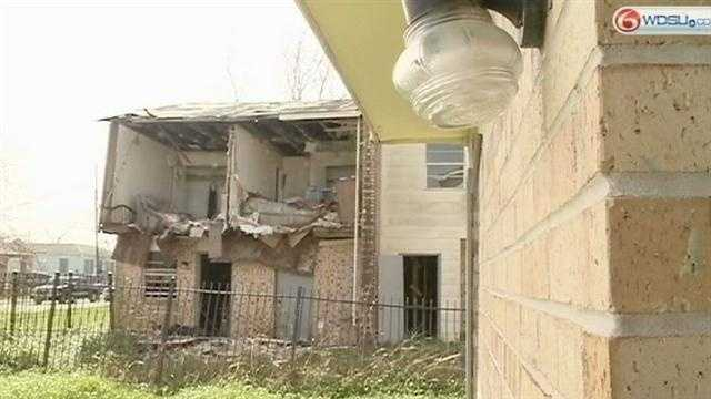 Neighbors complain about abandoned apartments