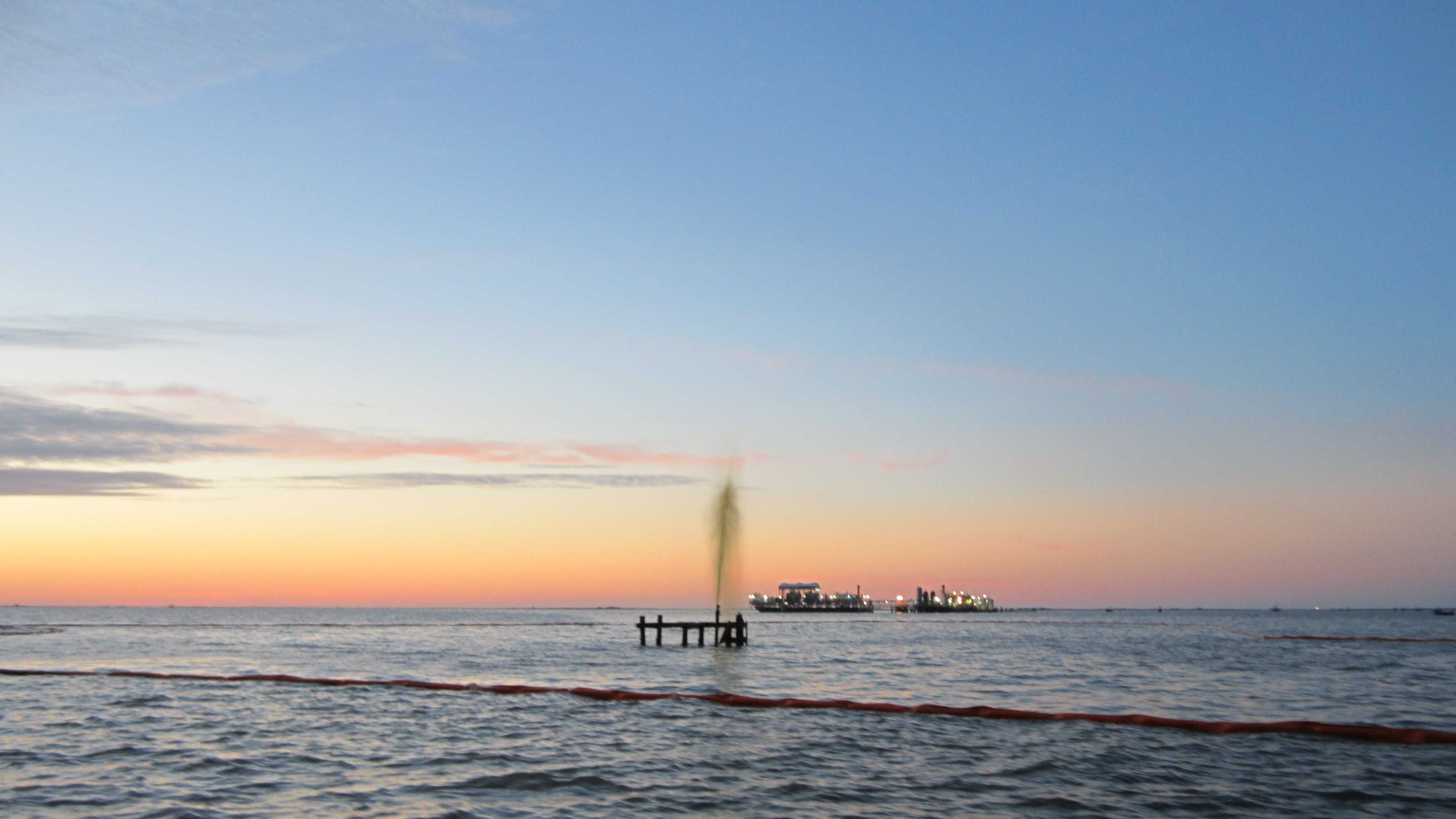 A wellhead was struck by a vessel near Port Sulphur Tuesday night, which caused an oily-water mixture to discharge into the water, the Coast Guard said.