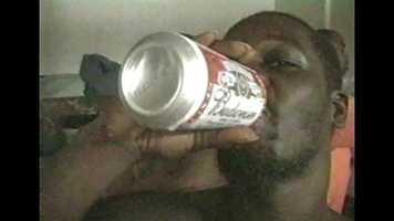 Inmate drinking beer.
