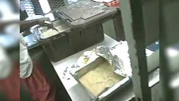 Inmates show that they are served food adjacent to the community shower. The inmates do not use gloves to serve food and are allowed to use metal utensils to serve the food from bins. Click here to read the story