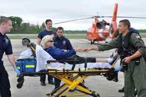 Beverly Parsons receives help from emergency personnel at Coast Guard Air Station New Orleans after being air-lifted from a sailing vessel in the Gulf of Mexico, Friday. Parsons and Carl Herman Hagenkotter Jr. were both air lifted by the Coast Guard after their sailing vessel's mast broke 50 miles southwest of Terrebonne Bay.