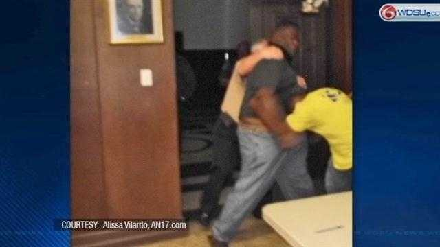 Two men throw punches after city council meeting
