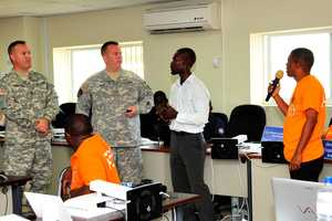 PORT-AU-PRINCE, Haiti - Louisiana National Guard military engagement team instructors Sgt. 1st Class James Ballow of Baton Rouge, La., and Maj. Robert N. Fudge of St. Francisville, La., instruct officials from the Haitian Directorate of Civil Protection during a simulated disaster exercise at the national emergency operations center in Port-au-Prince, Haiti, May 10, 2013. The LANG's MET is on a four-week mission to train the officials on effective emergency response management and emergency supplies storage and distribution.