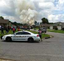 An eyewitness said he took this photo moments after a plane crashed in Baker, La.