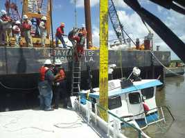 The two people aboard the 48-foot vessel were rescued by a passerby and transferred to a Coast Guard response boat.