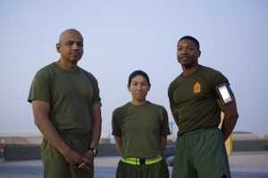 Marines with Combat Logistics Regiment 2, Regional Command (Southwest), pose for a picture at the start of a half marathon at Camp Leatherneck, Helmand province, Afghanistan, Oct. 10, 2013.