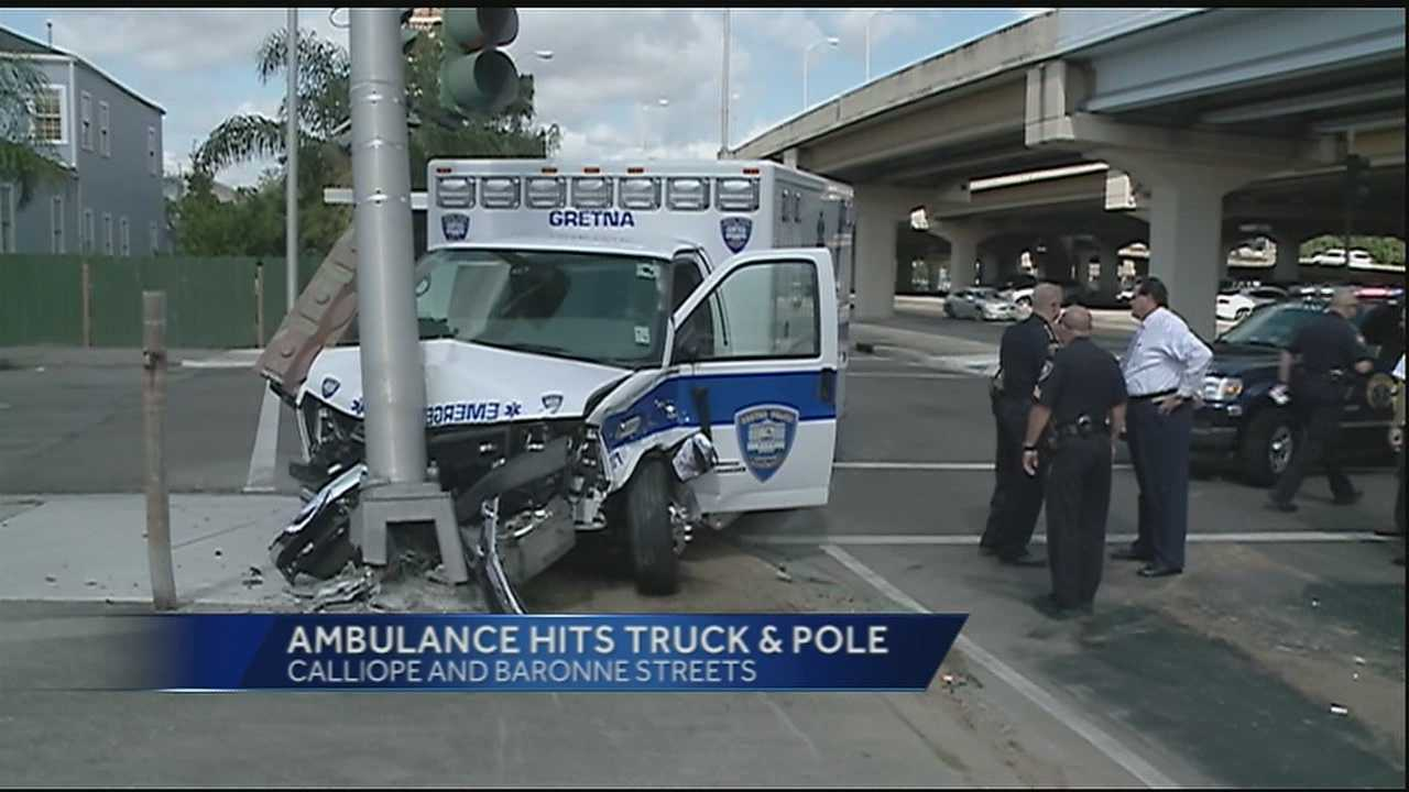 Ambulance hits truck, pole in New Orleans