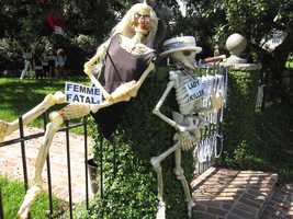 """There's a home on St. Charles Avenue that scares up some great laughs, using skeletons for """"punny"""" lines. Take a look at these photos from this year's offering!"""