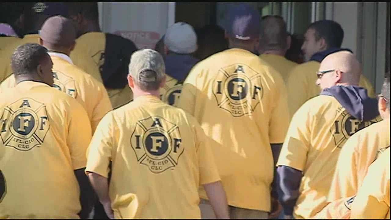New Orleans firefighters are battling the city's proposed budget at City Hall.