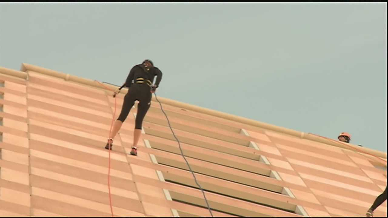 Dozens rappel 25 stories to benefit the Special Olympics
