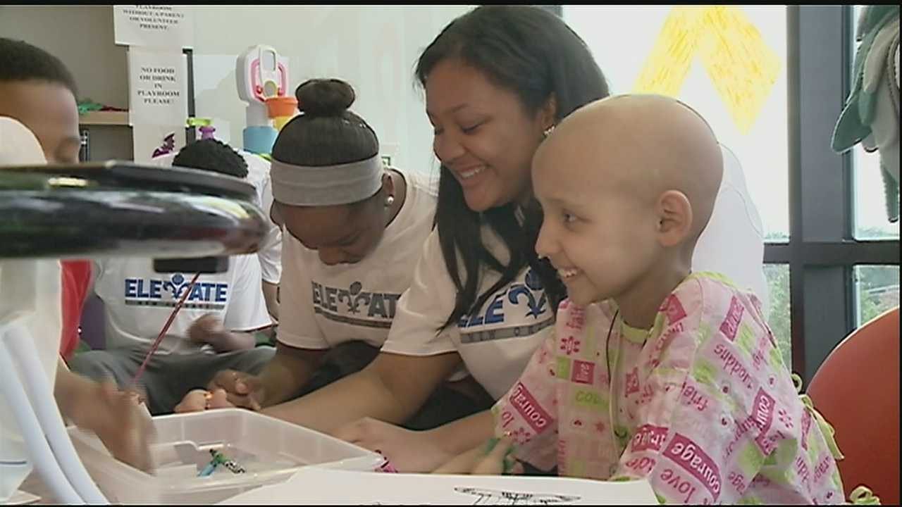 Youth athletic program visits patients at Children's Hospital