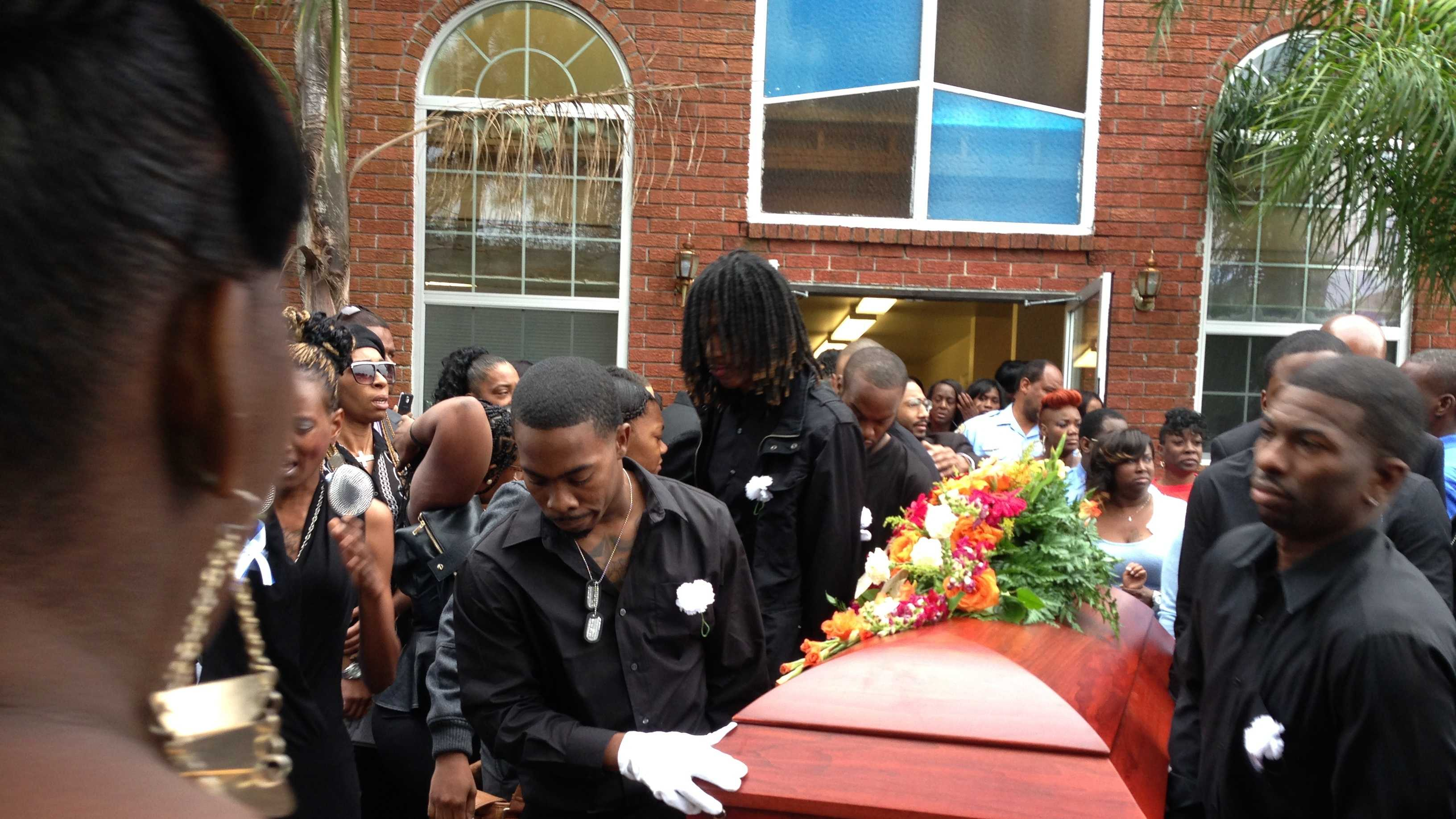 Street violence claimed their lives. A father and his infant son were laid to rest Saturday but not before many people packed inside a church to say their final goodbyes.