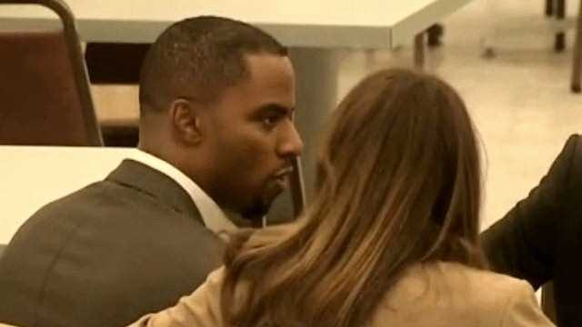 Darren Sharper meets with his attorney during a recent court appearance in Los Angeles.