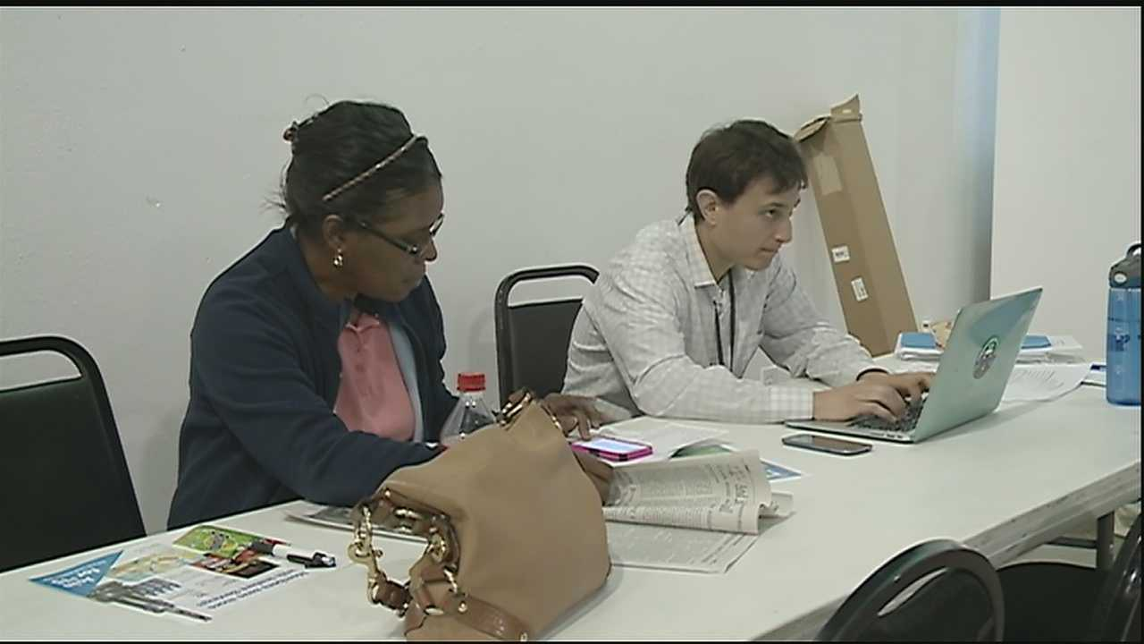 As Monday's midnight deadline loomed for people to sign up for the Affordable Care Act, people flooded community centers around New Orleans to get logged in and registered.